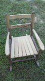 Very old solid oak child's rocking chair in Fort Campbell, Kentucky