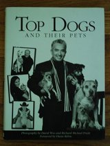 """Top dogs and Their pets""  By David Woo (2009 Hard in Plainfield, Illinois"
